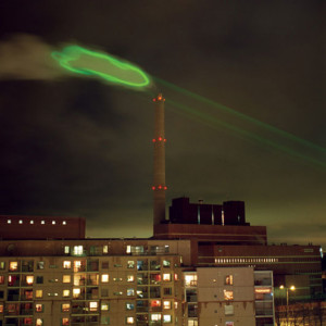 Photo of vapor emissions from the Salmisaari coal burning power plant illuminated with a high power green laser animation.