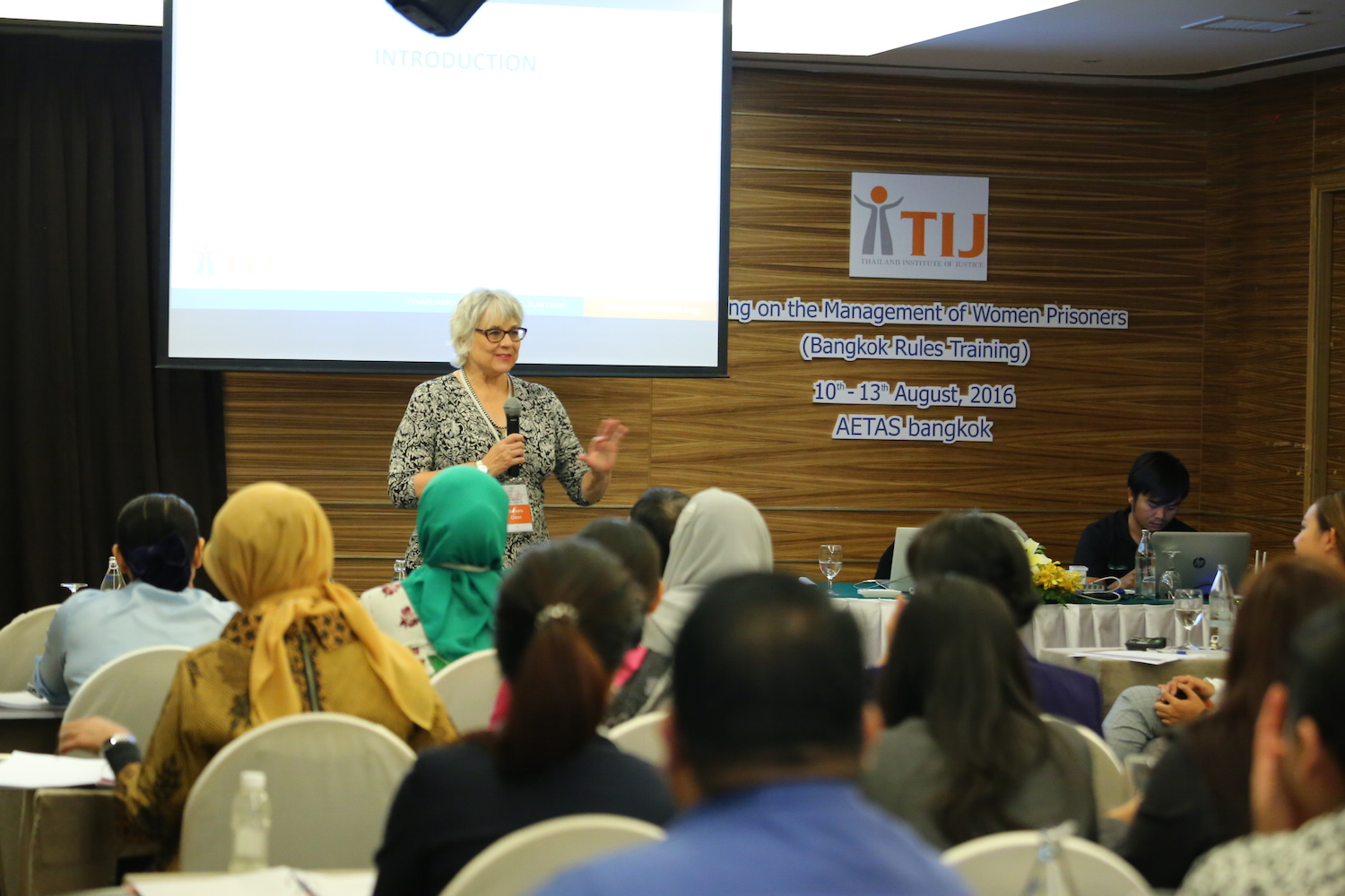 Author Barbara Owen speaking in front of Thailand Institute of Justice program attendees on Bangkok Rules.