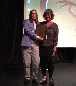 Julie Guthman (right) receives the AFHVS Excellence in Research Award.